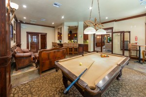 Two Bedroom Apartments for Rent in Katy, TX - Clubhouse Pool Table, Kitchen & Seating Area