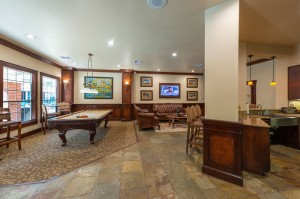 Two Bedroom Apartments for Rent in Katy, TX - Clubhouse Pool Table, Seating Area & Kitchen