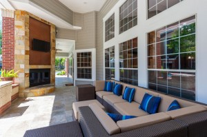 Two Bedroom Apartments for Rent in Katy, TX - Covered Outdoor Seating Area with Fireplace & TV