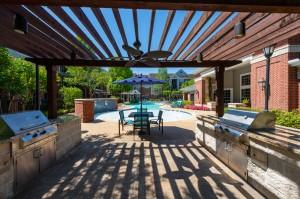 Two Bedroom Apartments for Rent in Katy, TX -  Outdoor Pergola Grilling Area and Seating with Pool View