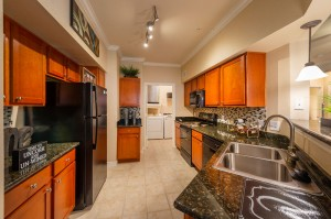 Three Bedroom Apartments for Rent in Katy, TX - Model Kitchen with Laundry Room View